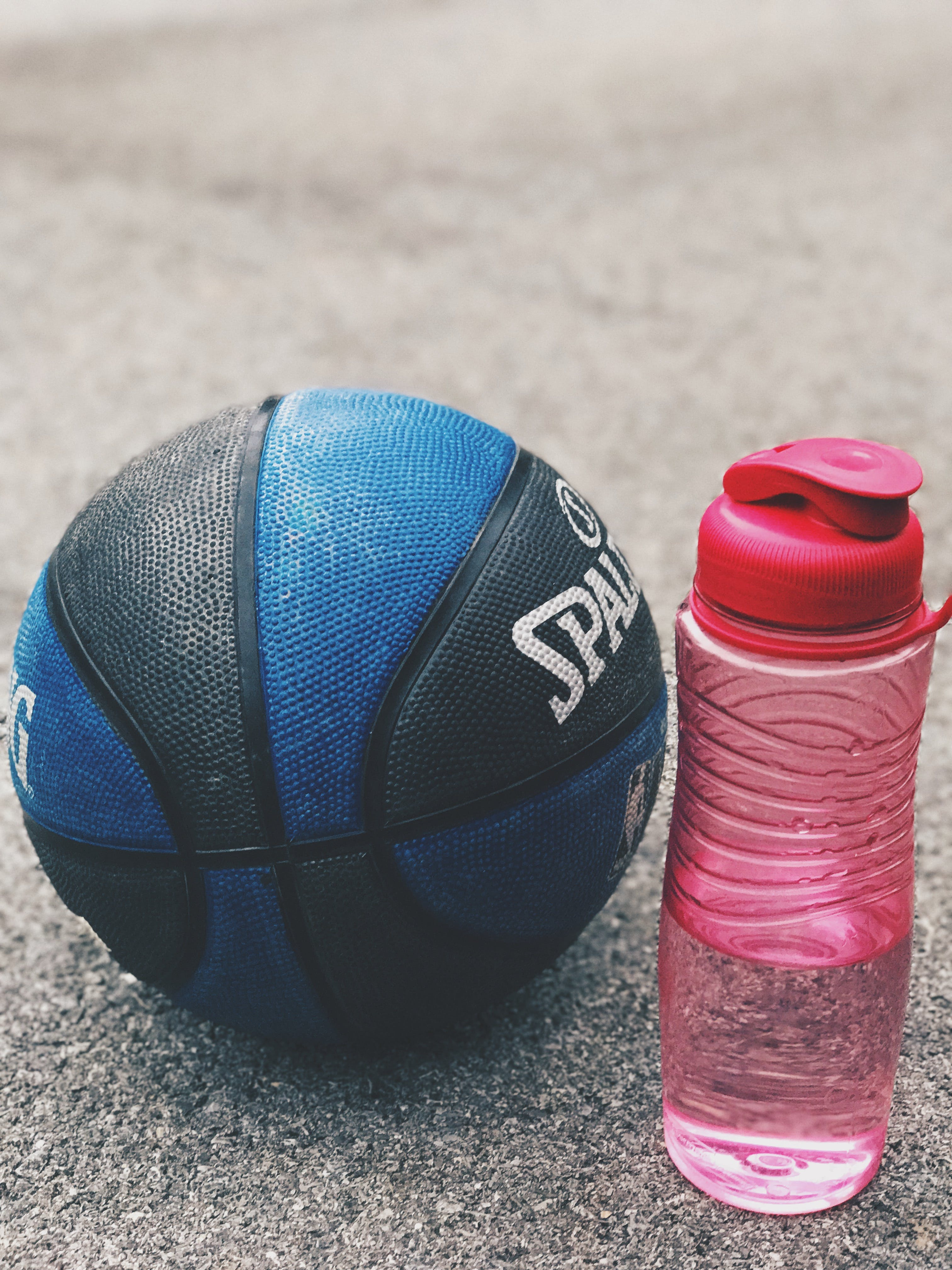 Photo of Basketball Near Pink Water Bottle